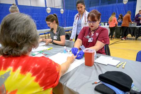WSU students volunteering at a health fair.