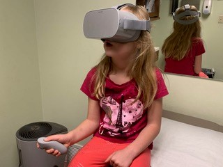 Closeup of Sydney Reese wearing a VR headset.
