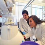 Alan Goodman and Marena Guzman in the lab.