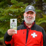 Daniel Baker holding a Discover Pass