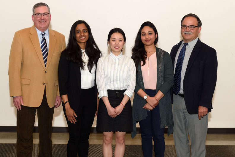 Last year's 3MT winner, Sheena Dong, center, stands with other 3MT contestants, WSU President Kirk Schulz.