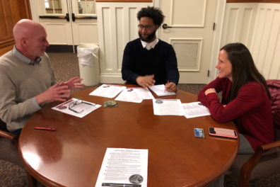 Honors College Dean Grant Norton (left), Trymaine Gaither (Honors College) and Joanne Greene (University Recreation) discuss a series of mindfulness activities planned for MLK Week.
