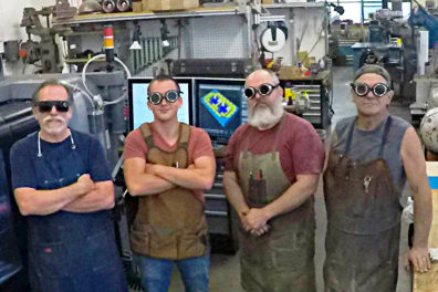 A group of shop workers in the Voiland College Engineering Shops.