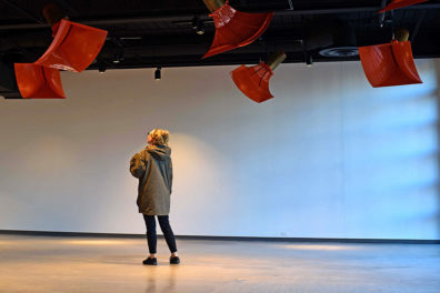 A woman looks up at Ambiente432, an art installation at the Jordan Schnitzer Museum of Art.
