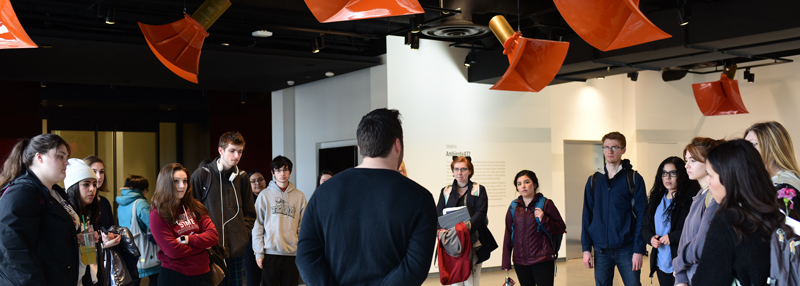 A tour group underneath Ambiente432, an art installation at the Jordan Schnitzer Museum of Art.