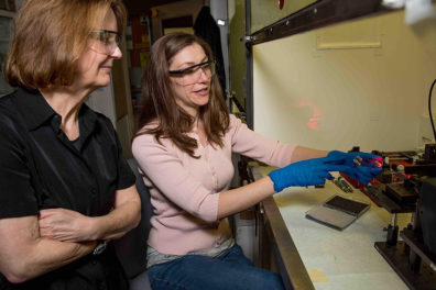 PNNL chemists Sue Clark (left) and Amanda Lines (right) evaluate a laser-based on-line monitoring system for radionuclides in the Radiochemical Processing Laboratory.