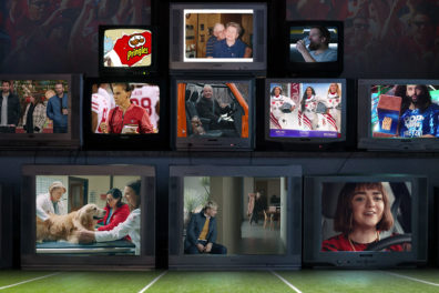 Stack of televisions featuring ads aired during Super Bowl LIV.