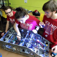 Crimson Robotics team members work on a prototype robot.