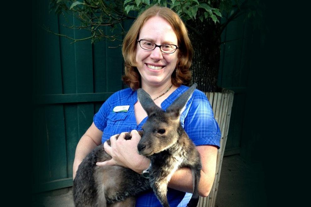Woman holding a small kangaroo.