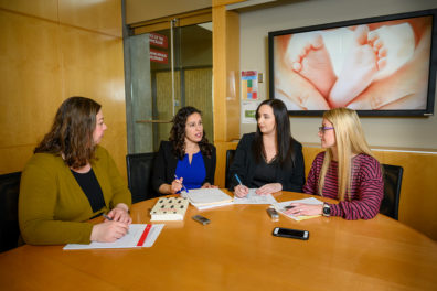 Authors Ekaterina Burduli, Celestina Barbosa-Leiker, Olivia Brooks, and Crystal Lederhos (from left to right) meet to discuss their study findings.