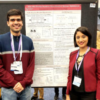 Graduate students Aryan Deshwal and Syrine Belakaria presenting at the NeurIPS conference.
