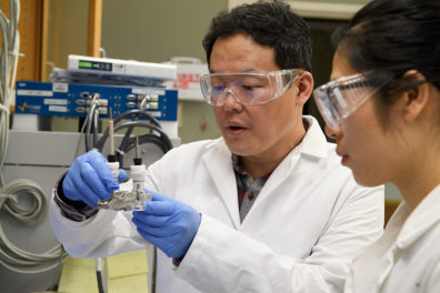 Professor Min-Kyu Song and graduate student Panpan Dong test a prototype of a lithium metal battery.
