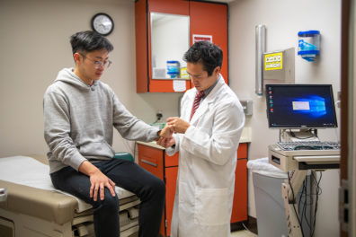 Physician Leyen Vu examines a student at Cougar Health Services.