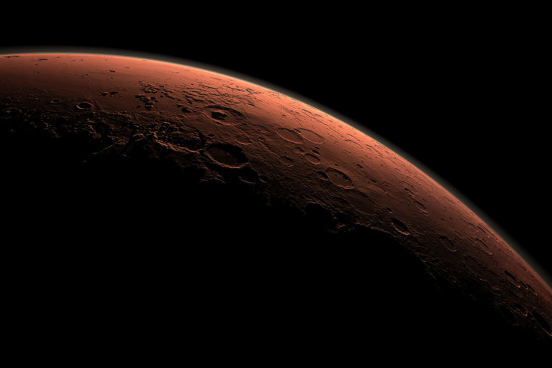 Computer-generated image of day break behind the curve of Mars.
