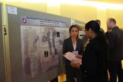 A student presents her research at the 2019 SURCA event.