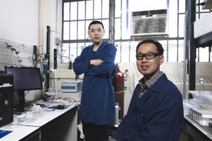 Los Alamos researchers Dongguo Li and Yu Seong Kim in their lab