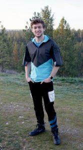 Closeup of Designer Justin Janke models a futuristic jacket from his fashion line.