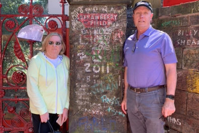 Bruce Amundson and Julie Parker standing outside Strawberry Field.