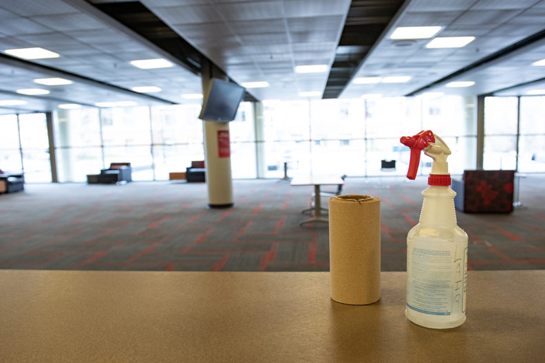 Cleaning supplies on a table in an empty lounge