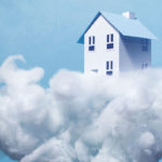 A house sitting on a cloud in the sky.