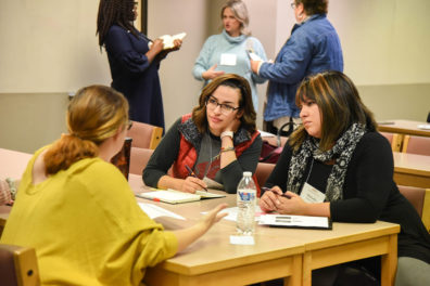 Veronica Romero (center) talks with colleagues at the WSU Tri-Cities Education Summit.