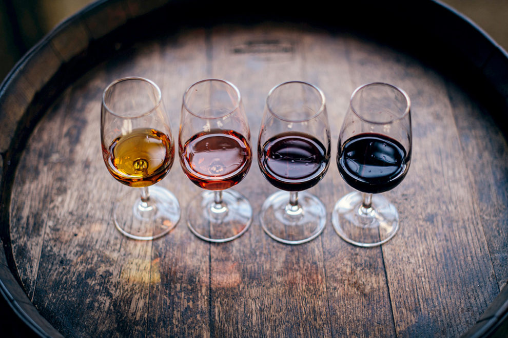 Four glasses of various types of wine.