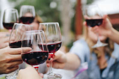 A group of people toast each other with wine