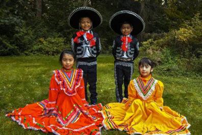 Children wearing traditional Latin American dance costumes.