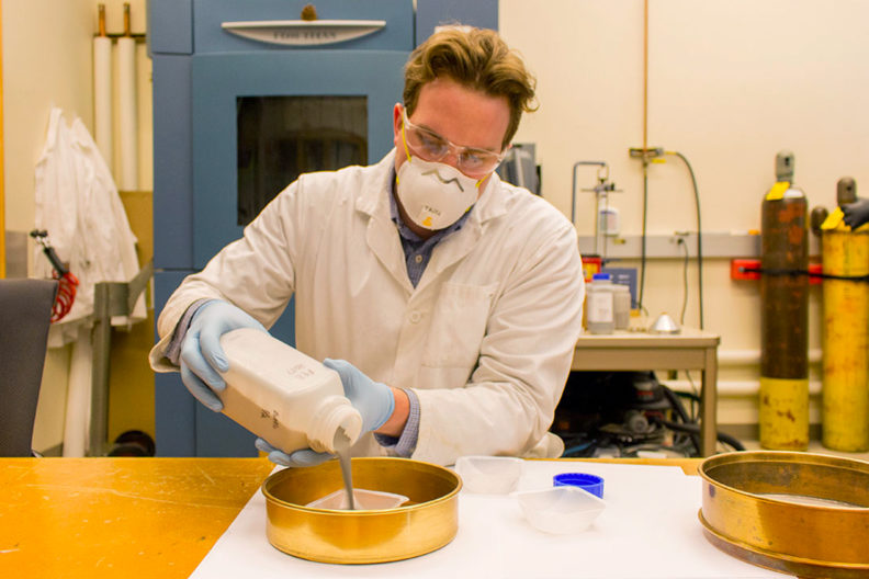 Kellen Traxel mixes together materials for 3D printing.