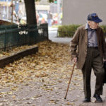 An old man goes for a walk.