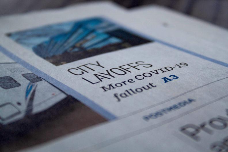 Newspaper headline that reads 'City layoffs.'