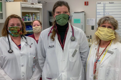 Members of the WSU Veterinary Teaching Hospital wearing cloth face masks.