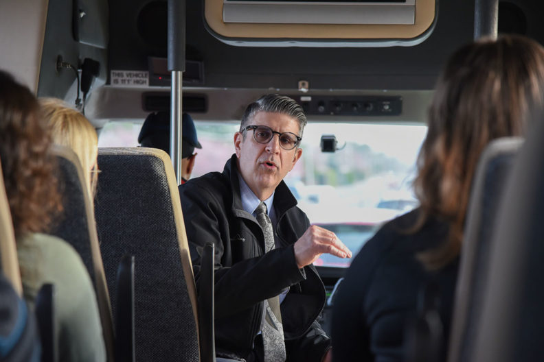 Michael Novakovich takes students on a bus tour of the Tri-Cities.