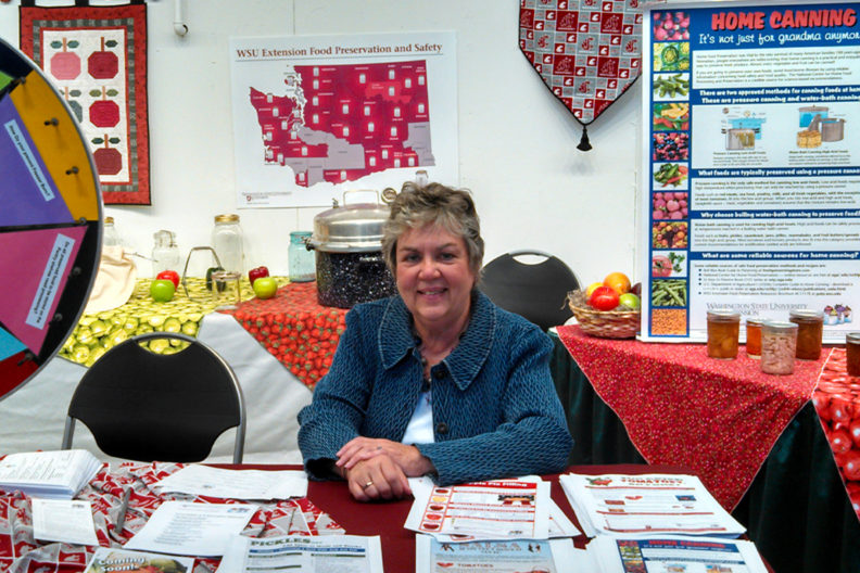 Margaret Viebrock surrounded by WSU Extension education materials.