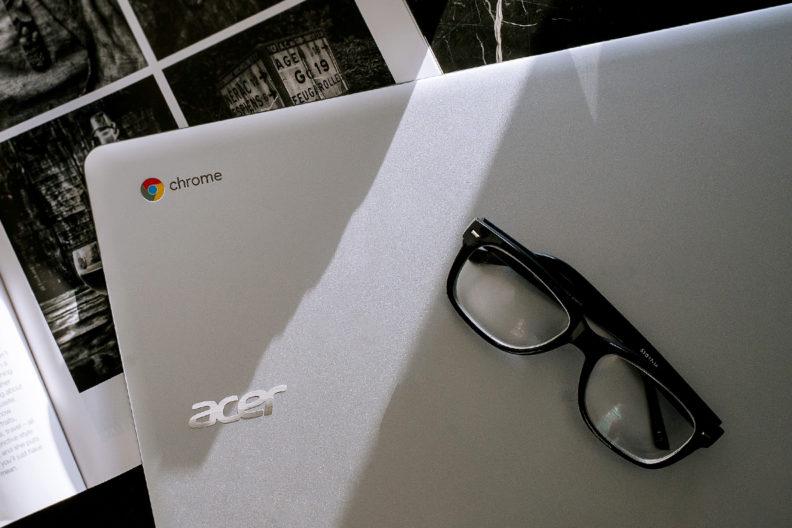 Closeup of a Chromebook and eyeglasses.