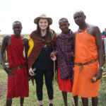 Thayer meets with members of the Maasai tribe in the Maasai Mara.