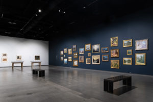 Exhibition wall showing paintings at the Schnizer museeum