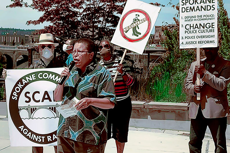 Sandy Williams speaking during an organized protest in Spokane.