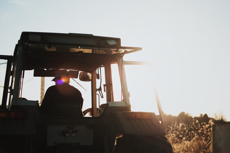 A man drives a tractor