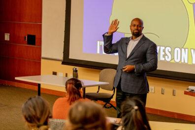 Justin Jones-Fosu gives a presentation to a class