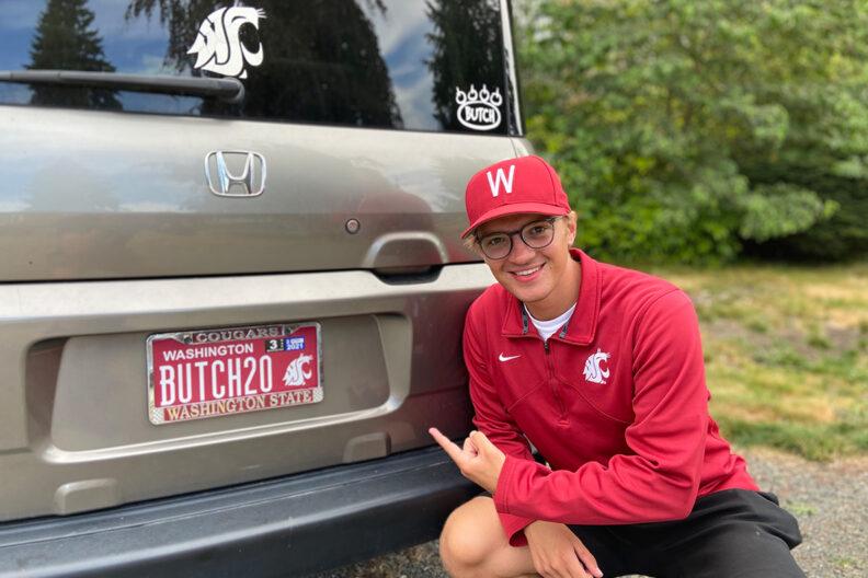 WSU alumnus displaying his Cougar license plate.
