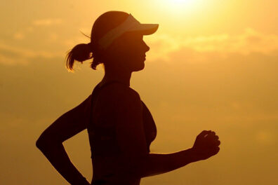 Silhouette of woman running.