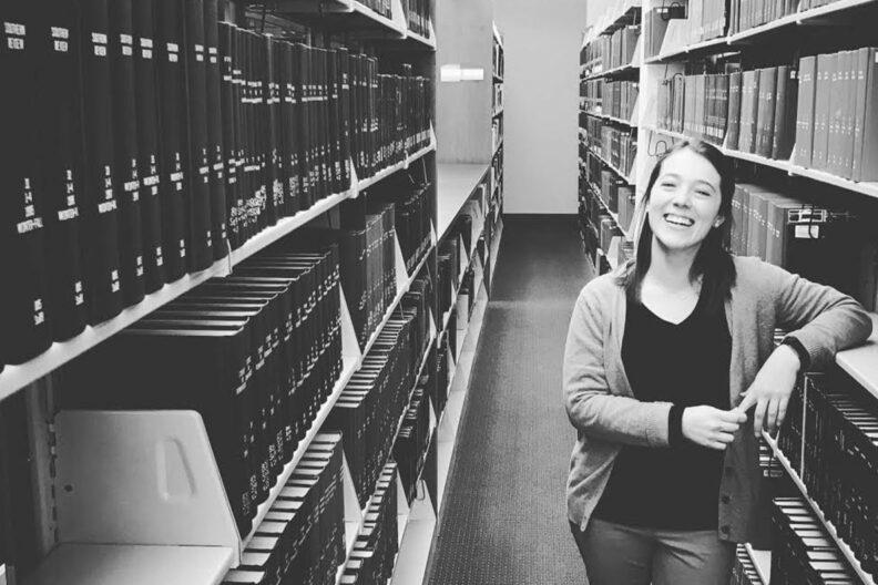 Jen Saulnier standing in aisle of a WSU library.