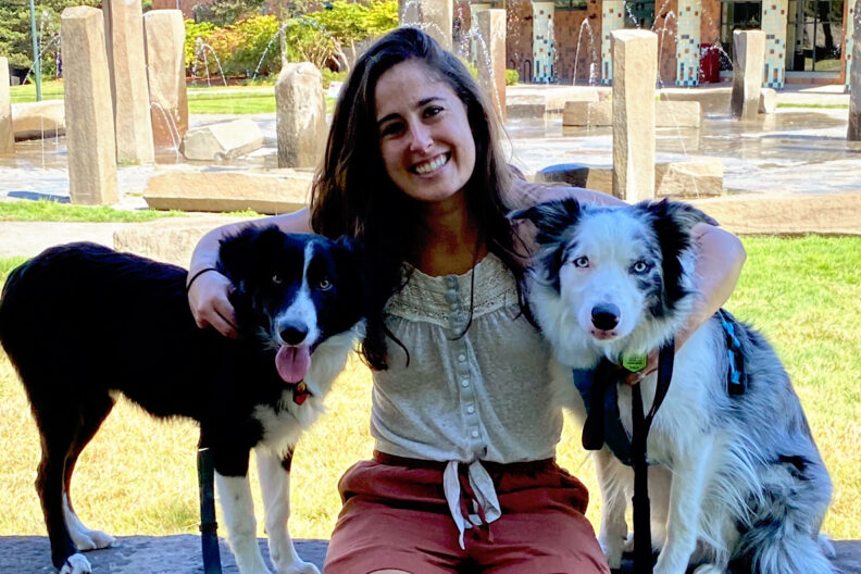 Closeup of Kelsey Pascoe with her dogs.
