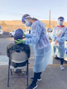 Yakima nursing student administering COVID-19 test.