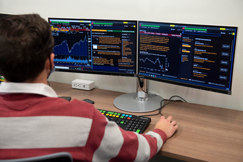 A student looks at financial data on a computer screen