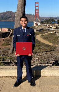 Troy Moya poses with his WSU diploma.
