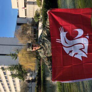 Vladi Ivanova poses with a WSU flag.
