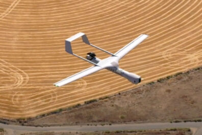 A drone flying over a wheat field