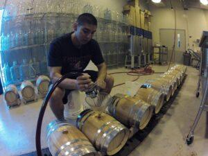 A recent PhD grad works in a wine laboratory